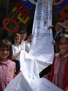 Children of Hartley Wintney present their fabric petition on climate change to their MP